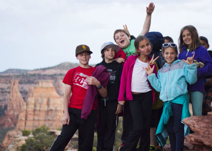 SOS Outreach youth hiking through Monument