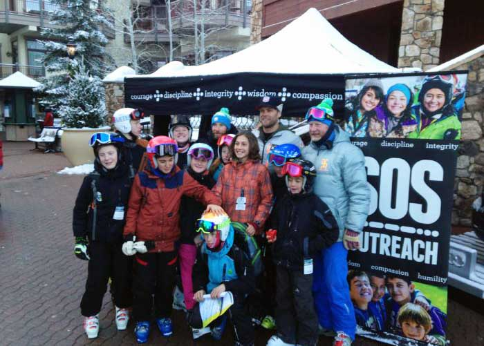 SOS Outreach youth dressed in snow gear at an event