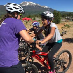 SOS Outreach youth learning to mountain bike