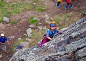 Girl rock climbing at Colorado Monument with SOS Outreach