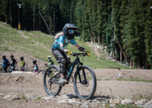 Girl riding a mountain bike at Keystone with SOS Outreach