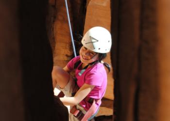 CNM Rock Climber on an SOS Outreach trip